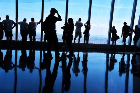 Backlit Silhouettes, People Looking at View from One World Trade Center Observatory, Manhattan New York City