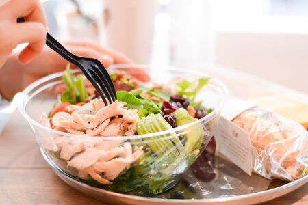 Chicken salad with avocado as healthy eating concept