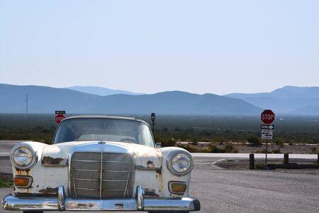 Old or vintage white car on the road Zdjęcie Seryjne