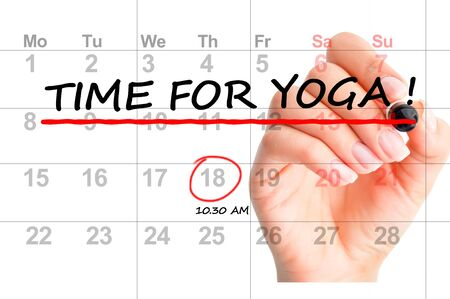 """Close-up of """" Time for yoga"""" text on calendar"""
