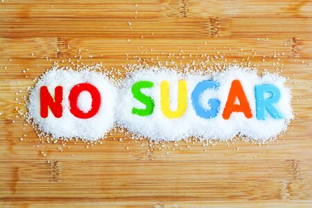 No sugar text from magnetic letters concept on wooden background Stock Photo