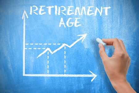 Retirement age concept with graph chart on blue chalkboard