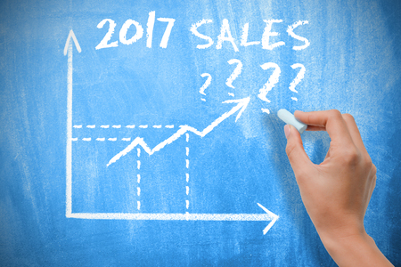 Sales forecast for 2017 with graph chart on blue chalkboard Stock Photo
