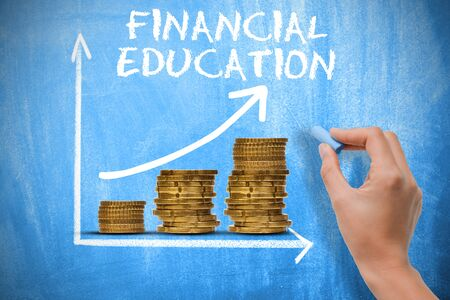 Financial education concept with piles of money and exponential growth chart on blue chalkboard Stock Photo