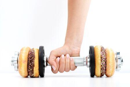 Pojęcie zdrowego stylu życia sugerowane przez pączki podnoszenia ciężarów Zdjęcie Seryjne - 73612061