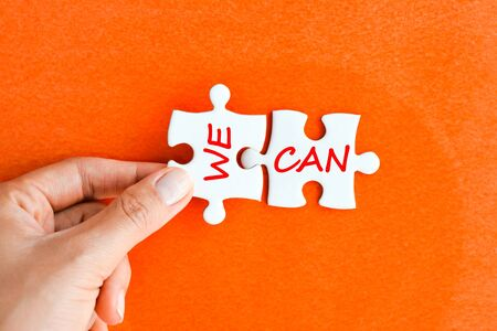 We can – positive message on puzzle pieces Zdjęcie Seryjne - 73612048
