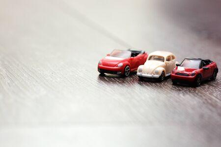 Vintage car models aligned on a wooden background