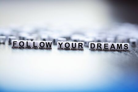 Follow your dreams text made from plastic letter beads Zdjęcie Seryjne