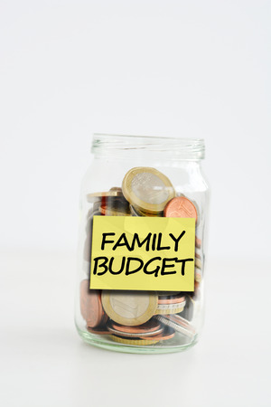 Family budget labeled jar filled with money Zdjęcie Seryjne