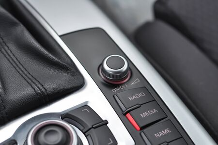 Car interior detail with close-up on multimedia buttons