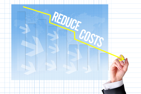 Reduce costs concept with businessman hand draw a graph Фото со стока