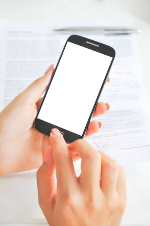 Woman hand with blank display of a mobile phone
