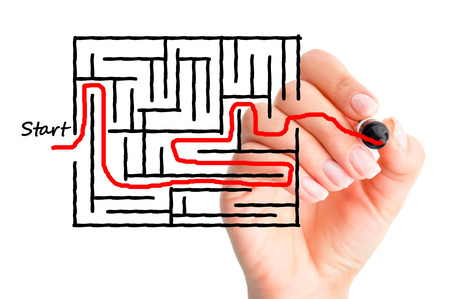 Labyrinth or finding solutions with woman hand solving a maze concept