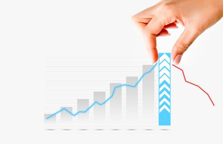 increase business: Human hand pulling graph bar suggesting increase of sales or business