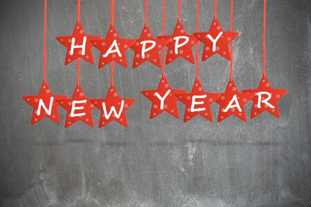 Happy new year wish with red stars isolated on blackboard background