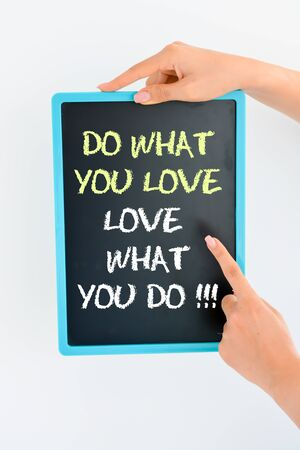 Do what you love and love what you do text on blackboard suggesting working with passion Zdjęcie Seryjne