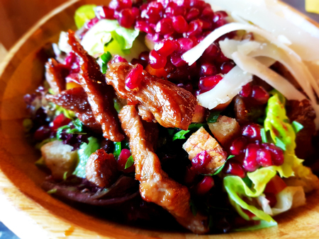 Tasty beef salad with pomegranate seed and iceberg lettuce