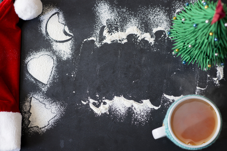 Christmas frame or background with cookie shapes and flour on blackboard Zdjęcie Seryjne