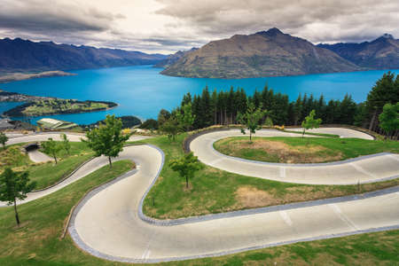 luge: Luge track with beautiful lake and mountain at Skyline, Queenstown, New Zealand