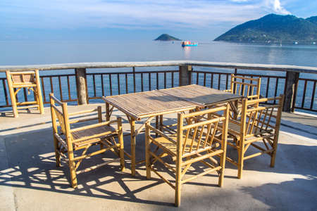 Wooden table in sea seaside restuarant, Koh Tao, Samui, Thailand photo