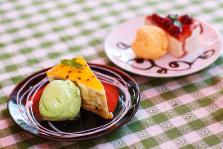 Icecream and cake in plate on  table photo