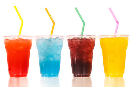 Multi-color cool soft drink with straw on isolated white background photo