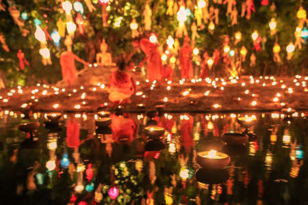 Floating candle with monk and buddha image in Thai temple ,Loy Krathong Festival, Chiang Mai, Thailand photo