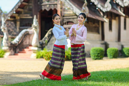 Girls with Thai northern style in Sawasdee action photo