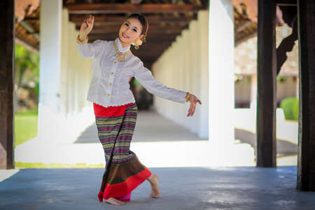 Thai dancing girl with northern style dress in temple, Chiang Mai, Thailand Stock Photo