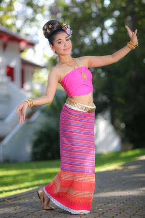 thailand: Thai dancing girl with northern style dress in temple, Chiang Mai, Thailand