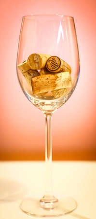 syrah: Corks in a wine glass, close up, background