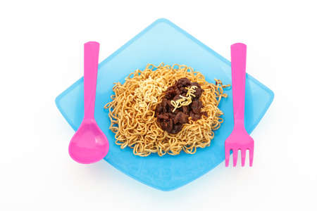 sapid: Eating noodles with fork and spoon on isolated white background