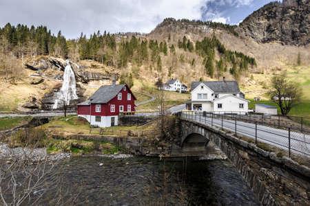 Steinsdalfossen waterfall with souvenir shop in Steine, Norway