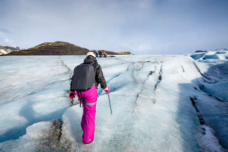 Female hiker walking on glacier at Solheimajokull, Iceland Stock Photo - 93469967