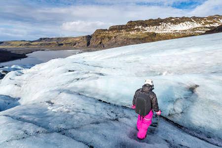 Female hiker walking on glacier at Solheimajokull, Iceland