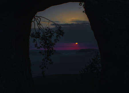 Creepy sunrise from the mountains with dark landscape Stock Photo