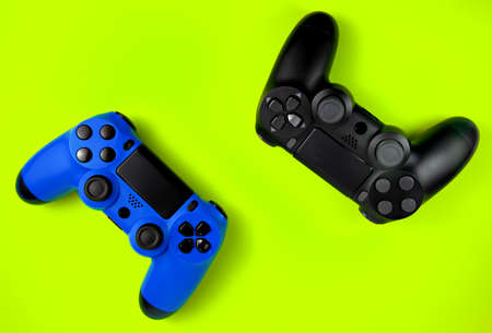 Set of video game joysticks gamepad on a green background. Concept of playing games or watching TV.