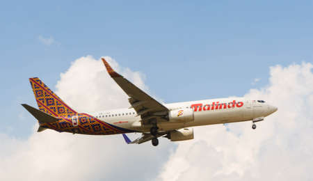 Kuala Lumpur, Malaysia, 15th March 2016, Malindo Air aircraft on landing approach at the airport Editorial