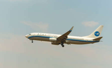 Kuala Lumpur, Malaysia, 15th March 201, Xiamen Airlines  aircraft on landing approach at the airport Editorial