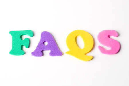 acronym for frequently asked questions formed with multicolor foam lettes photo