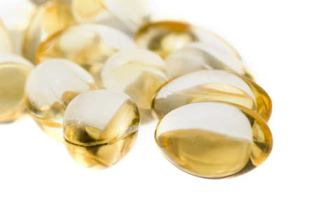 omega 3 pills close up on white background. selective focus