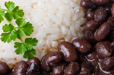 close up of cooked white rice and black beans