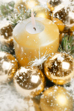Gold Christmas ornaments in vertical composition Stock Photo