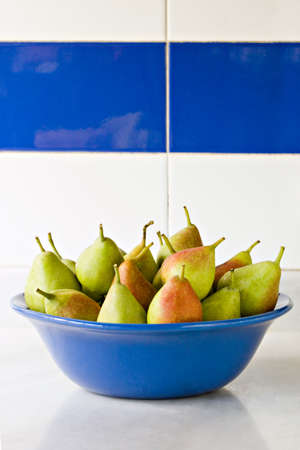 Large group of pears in blue bowl