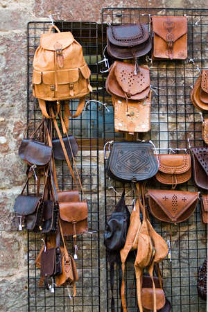 collection of casual leather bags on street market Standard-Bild