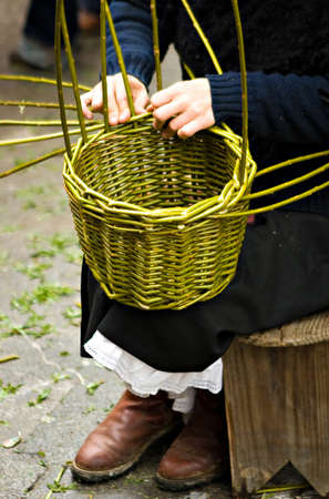 Woman´s hands making a wood basket