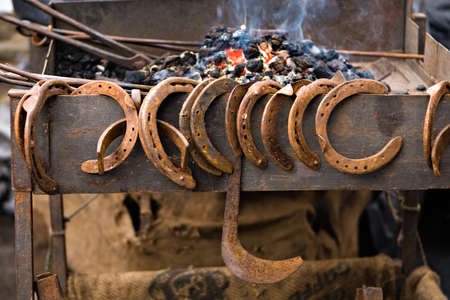 blacksmith forge and variety of horseshoes