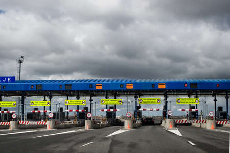 toll: Multiple lane toll barrier in Spain Stock Photo