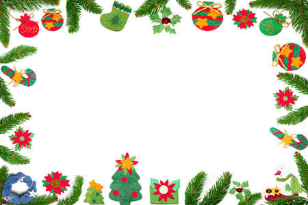 Christmas border made with paper ornaments and fir tree  Stock Photo