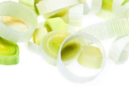 Raw chopped leeks on white background Standard-Bild